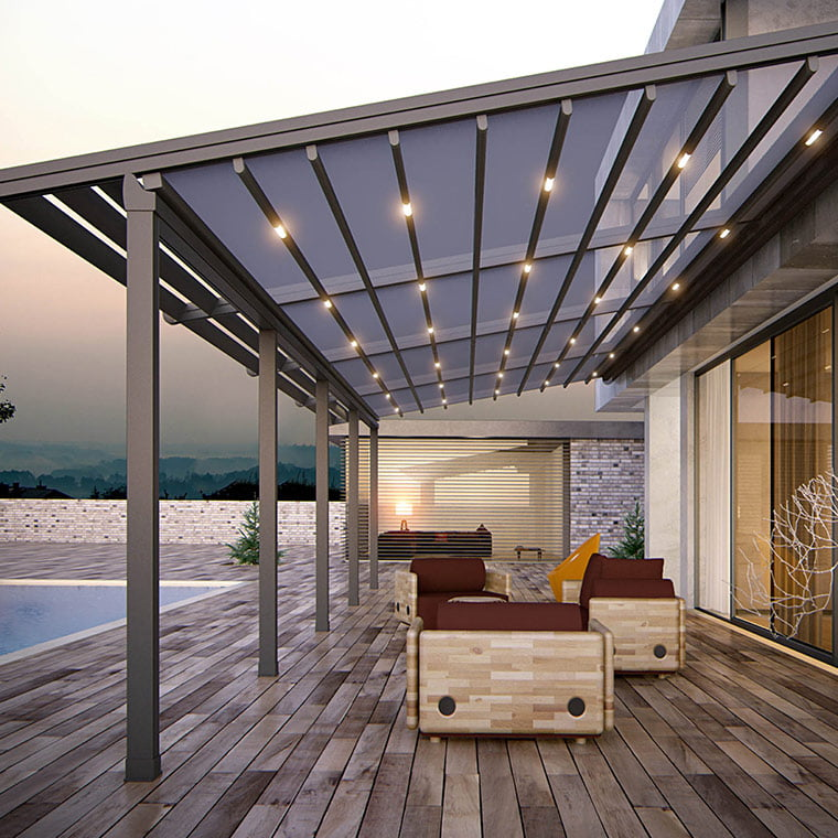 Motorized awnings installed in a luxurious courtyard
